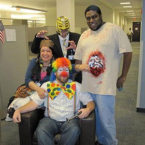 Halloween picture of employees dressed up in the office