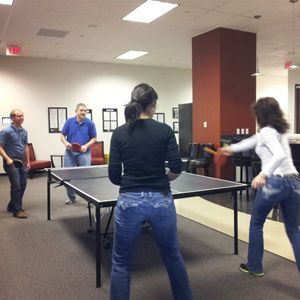 Ping pong match between coworkers...I think Gabi and Lori won
